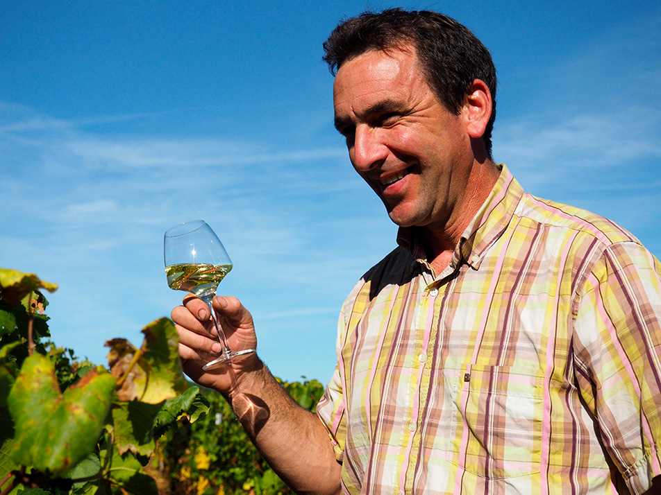 Shooting photo de Christophe Lapalus dans ses vignes